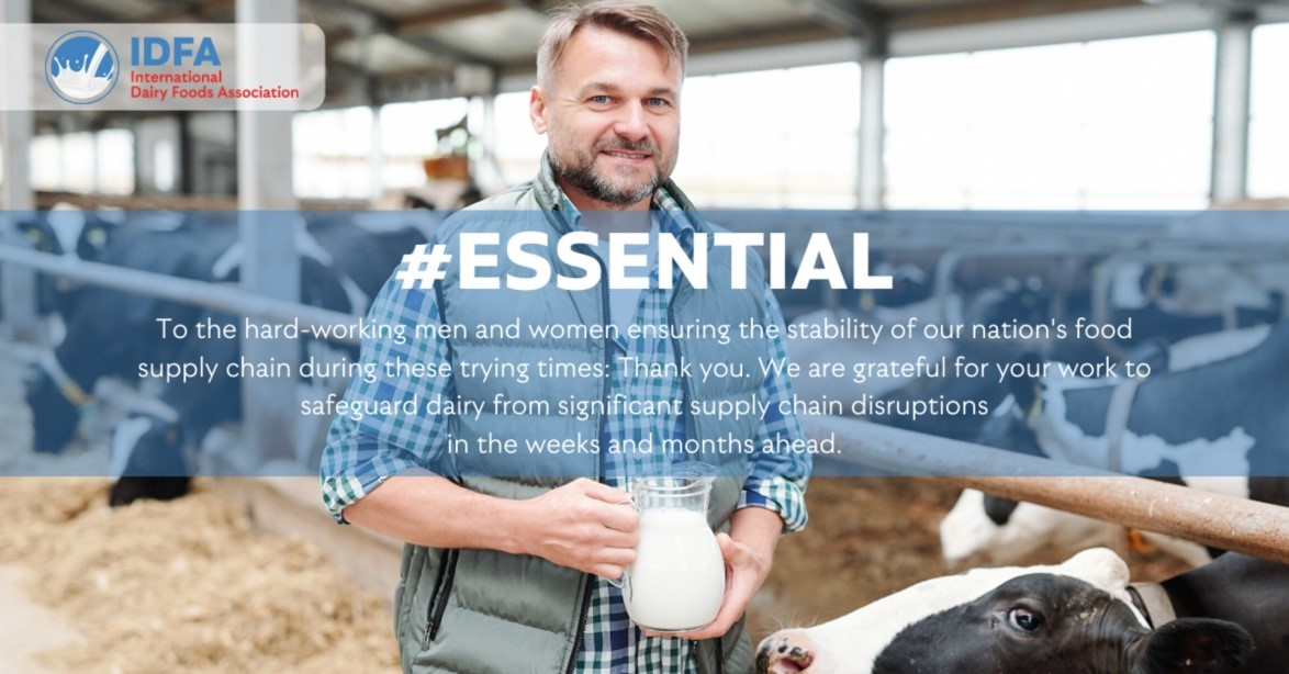 essential worker farmer with cow and milk
