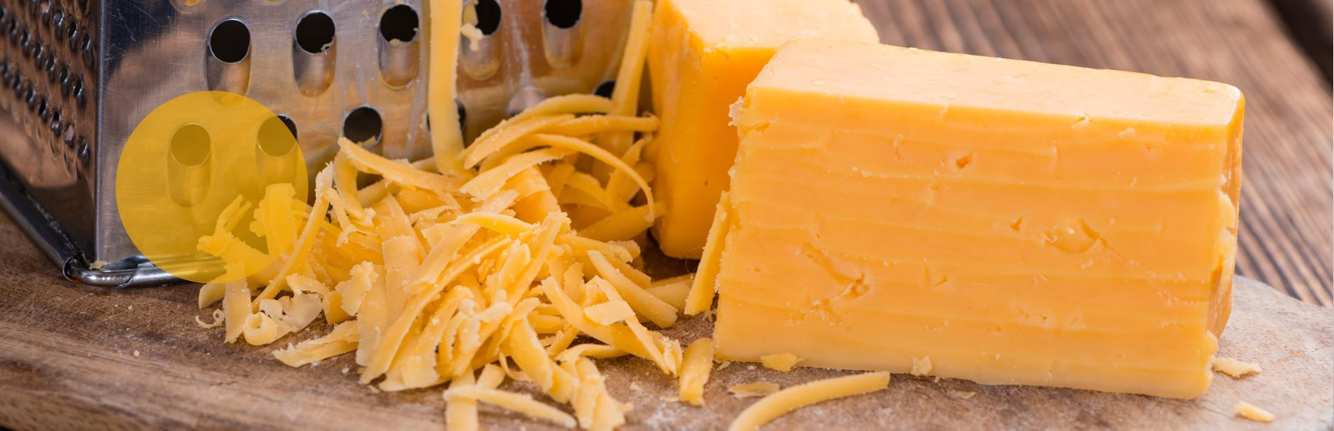 grated cheddar cheese and block of cheese